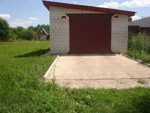 Большой гараж с навесом